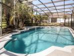 Enjoy gorgeous Florida days by this lovely screened-in pool!