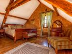 Our spacious master bedroom with California King size bed with an en suite bath / separate shower