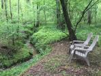 Sit by the running little creek behind the cabin.
