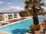 The swimming pool of the house with a beautiful view to the Aegean Sea and Naxos island.
