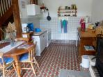 The kitchen has cooker, microwave, utensils, crockery and cutlery.
