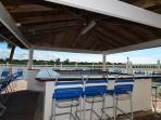Enjoy your grill food overlooking the Dolphins and Manatees -- waterside :)