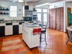 The fully equipped kitchen is open to the living room.