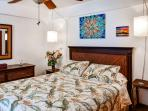 Rest your head on the queen bed in the master bedroom.