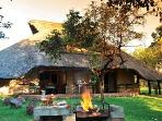 Front of lodge with braai area.