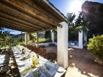Out doors dining on main terrace. Shaded and a beautiful spot for a leisurely meal.