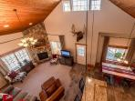 Great room features vaulted cedar ceilings, a stone gas fireplace and flat screen TV