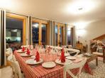 The dining area in the chalet is light and airy, with balcony access via the french windows