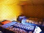 17 sleeping tents with comfortable beds, 4 in each tent. Sheets and blankets included. Lights inside