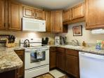 remodeled kitchen with granite counters, all appliances and lots of great cooking utinsels