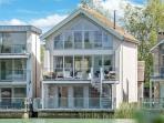 The stunning 5 Bedroom + 4 x Bathroom Corinium Lodge, set lakeside at The Lower Mill Estate