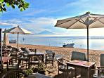 enjoy a relaxing cup of tea and cake at the popular café by the beach & admire the famous Mt Agung