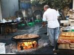 Paella cooked at AYO Chiringuito de AYO on Burrianna  Beach. Cooked fresh daily all you can eat.