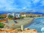 View towards the building and Penoncillo beach with the surrounding mountains.