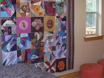 hand made quilt in second bedroom