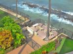 community deck and stairs into ocean
