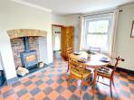 The dining area in the large farmhouse kitchen is perfect for family meals