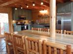 Kitchen with stainless appliances; farm-style table seats 12 comfortably