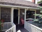 Crisp, refreshing water side entrance, wooden chairs, sep entrance to kitchen, 2 ways into yard