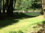 Walk through garden area to river and dock