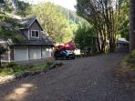 As you enter driveway cabin is to right with plenty of parking. Main house is not used when rented