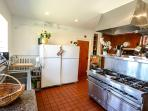 Incredible kitchen with 2 ovens, 10 gas burners, 2 refrigerators and lots of pantry space.