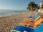 Lounge chairs and umbrellas at Beach for your use