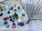 Stroll along the shore and collect sea glass to craft your dazzling jewelry