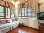 Bamboo bedroom with an extra single bed, flat screen TV and DVD player