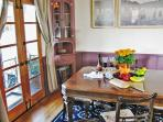 Dining room with French doors to private balcony overlooking fountain garden.