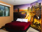 2nd Bed room with full bath TV and Foto Mural