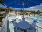 Relax in sun or shade on the pool deck