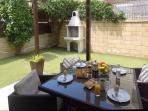 Enjoy breakfast on the back patio