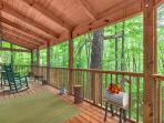 Incredible covered screen porch with rockers.