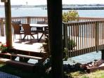 deck over water for crabbing and fishing or kayak launching beach here at low tide underneath