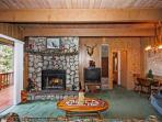 Living room has rock fireplace