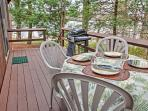 The spacious back deck is perfect for dining and unwinding.