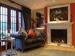 Fabulous small sitting area with large LCD tv open real gas fire and wonderful loch views