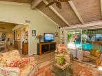 Living room view to dining area; Pool & Spa area. Open beam redwood ceilings.