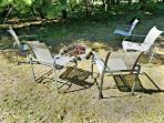 Relax Around the Firepit with a Wooded Setting
