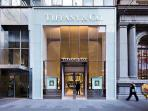High-end retailers on round the corner on Collins St.