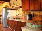 Fully stocked kitchen with large fridge, dishwasher and stove/oven