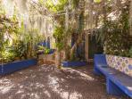 Traditional pebble paved courtyard with assorted sub tropical trees and climbers