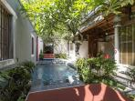 Sunny courtyard is the perfect place to relax by the pool.
