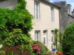 No 8, Rue Laitiere nestled in its courtyard garden