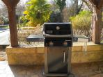 Sarlat Holiday rental - New Gas BBQ on undercover terrace next to dining table overlooking the pool