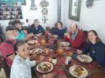 Breakfast with guests.  Irene is in left front.  This is a 'build your own burrito morning. Yum