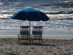 Rent beach chairs and umbrellas from lifeguard