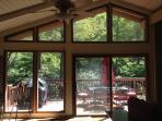 The patio off the living area feels like a tree house