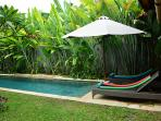 Tropical gardens and the large pool are great features of this pool.